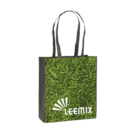 A shopping bag with a photo of green grass printed on the side, available at Drukzo for a cheap price