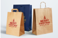 Give your customers paper bags with your logo for Christmas to help them package their gift
