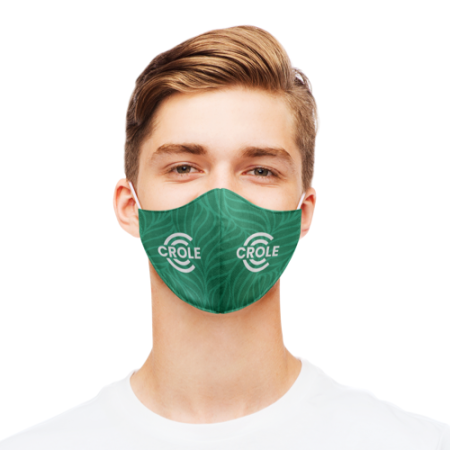 A man wearing a close fitted face masks personalised with a green-leaf design.