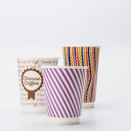 Multiple double walled paper cups with varying designs, available at Helloprint with full customisation for a cheap price